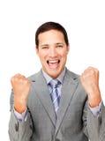 Homme d'affaires chanceux poinçonnant l'air dans la célébration Photos stock