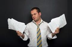 Homme d'affaires chargé et frustrant photo libre de droits