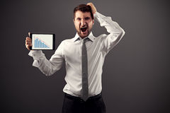 Homme d'affaires choqué avec le rapport Photographie stock