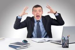 Homme d'affaires choqué dans la panique Image libre de droits