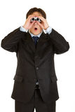 Homme d'affaires choqué regardant par des jumelles Photos libres de droits