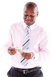 Homme d'affaires comptant l'argent Photographie stock libre de droits