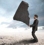 Homme d'affaires contestant les difficultés Photographie stock libre de droits