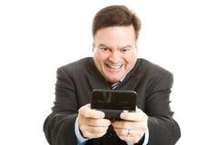 Homme d'affaires corné Texting photographie stock libre de droits