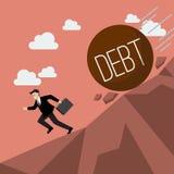 Homme d'affaires courant à partir de la dette lourde qui roule vers le bas à lui Photographie stock libre de droits