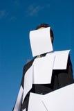 Homme d'affaires couvert de papiers Image stock