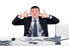 Homme d'affaires couvrant ses oreilles plus de Photo stock