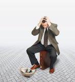 Homme d'affaires désespéré demandant l'aumône photos libres de droits