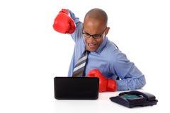 Homme d'affaires d'Afro-américain, gants de boxe Photographie stock