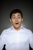 Homme d'affaires d'expressions dans la chemise blanche choquée Photo libre de droits