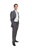 Homme d'affaires d'isolement au-dessus du fond blanc Photographie stock libre de droits