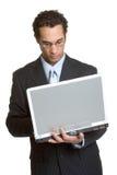 Homme d'affaires d'ordinateur portatif Photographie stock