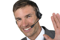 Homme d'affaires dans des écouteurs avec un microphone Photographie stock