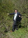Homme d'affaires dans des buissons d'épine Photo libre de droits