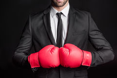 Homme d'affaires dans des gants de boxe Photographie stock libre de droits