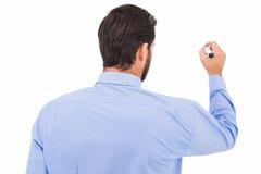 Homme d'affaires dans l'écriture de costume avec le marqueur Images libres de droits