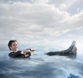 Homme d'affaires dans l'eau Photographie stock libre de droits