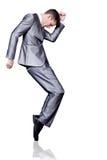 Homme d'affaires dans la danse argentée de procès. D'isolement. Image stock