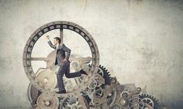 Homme d'affaires dans la roue Photographie stock libre de droits