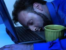 Homme d'affaires dans le bleu (fonctionnant tard) Photos libres de droits