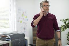 Homme d'affaires dans le bureau Photos stock