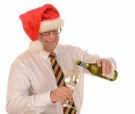 Homme d'affaires dans le chapeau de Santa photos stock