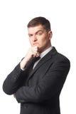 Homme d'affaires dans le costume avec la main sur le menton Photo libre de droits