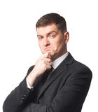 Homme d'affaires dans le costume avec la main sur le menton Photo stock