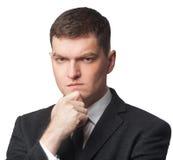 Homme d'affaires dans le costume avec la main sur le menton Images stock