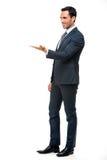 Homme d'affaires dans le costume avec le bras soulevé Images stock