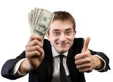 Homme d'affaires dans le costume montrant la fan de l'argent Photos stock