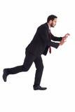 Homme d'affaires dans le costume poussant avec des mains Photo stock