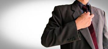 Homme d'affaires dans le costume prêt pour le combat photographie stock libre de droits