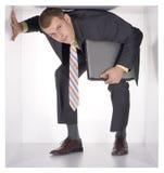 Homme d'affaires dans le cube Image stock