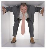 Homme d'affaires dans le cube Photographie stock libre de droits