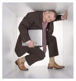 Homme d'affaires dans le cube photographie stock