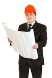 Homme d'affaires dans le plan de construction de fixation de casque Photographie stock libre de droits