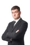 Homme d'affaires dans le procès avec les bras croisés Photographie stock