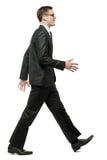 Homme d'affaires dans le procès noir sur le blanc. photos stock
