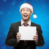 Homme d'affaires dans le signe de fixation de chapeau de Santa Photo libre de droits