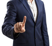 Homme d'affaires dans un costume dirigeant le doigt Images stock
