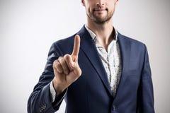 Homme d'affaires dans un costume dirigeant le doigt Photographie stock