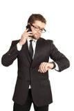Homme d'affaires dans un procès parlant au téléphone Photographie stock