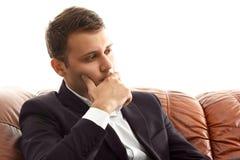 Homme d'affaires de pensée tenant son menton Photos stock