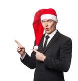 Homme d'affaires de Santa montrant sur le fond vide Image stock