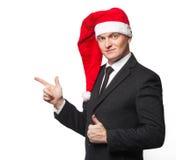 Homme d'affaires de Santa sans sourire montrant le fond vide Photos stock