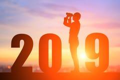 Homme d'affaires de silhouette avec 2019 photographie stock