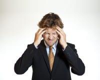 Homme d'affaires de souffrance avec la migraine Photo stock