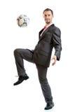 Homme d'affaires de sourire avec un football Photos libres de droits