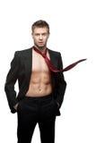 Homme d'affaires de sourire sexy dans la relation étroite rouge Photographie stock libre de droits